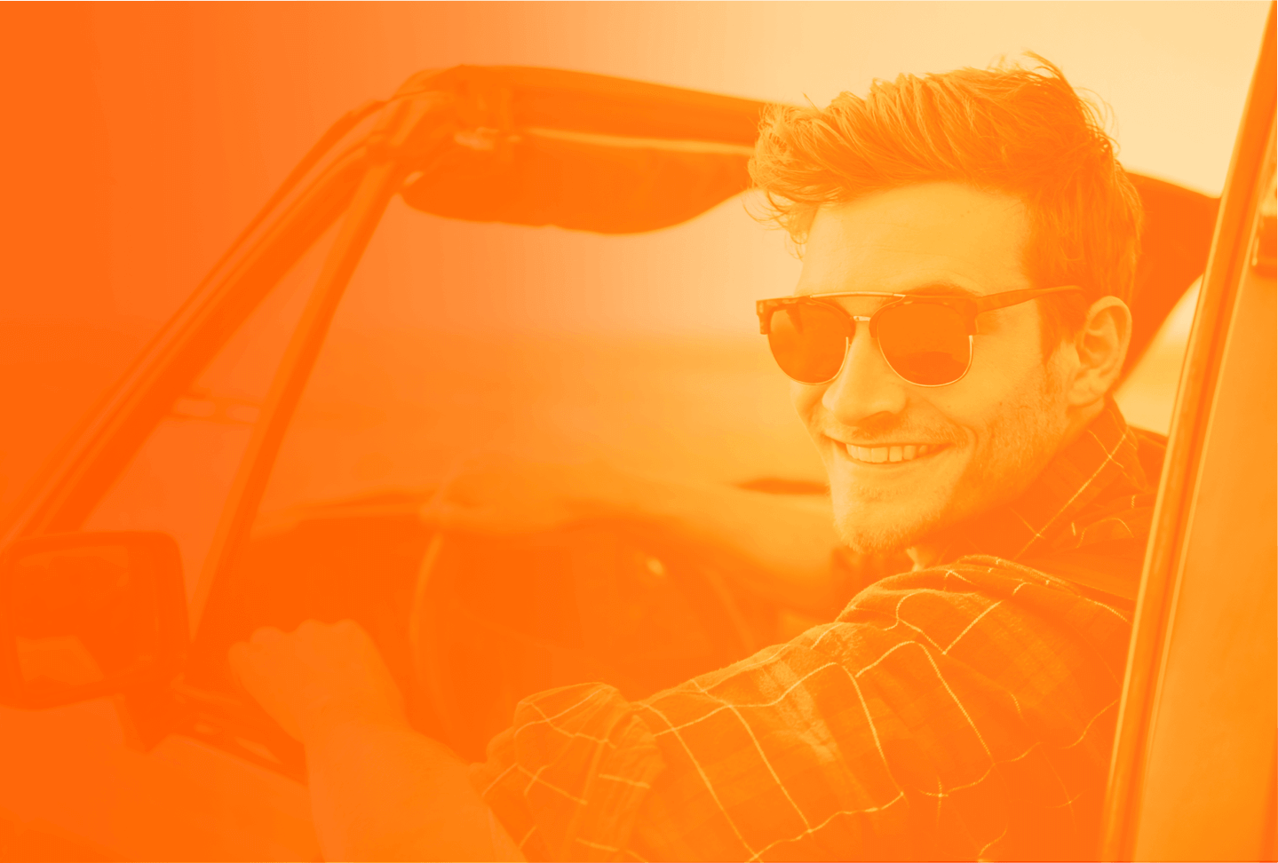 man smiling in a car